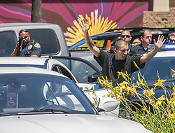 June 26, 2017 - Anaheim, CA, USA - Police arrest a man at their station after the pursuit of a stolen white Mercedes through Anaheim, CA on Monday, June 26, 2017. The vehicle theft suspect called 911 during the pursuit to inform police he would be driving to the police station. (Credit Image: © Ken Steinhardt/The Orange County Register via ZUMA Wire)