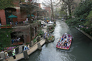 The River Walk along the San Antonio River in downtown San Antonio, Texas. Tourist boat.