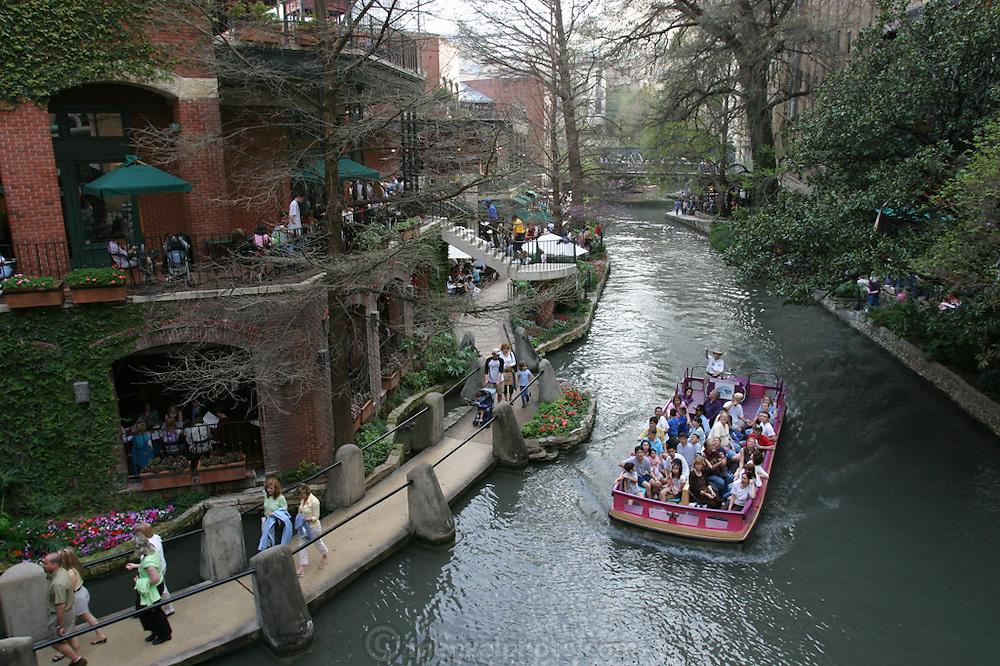 The River Walk along the San Antonio River in downtown San Antonio, Texas. Tourist boat.