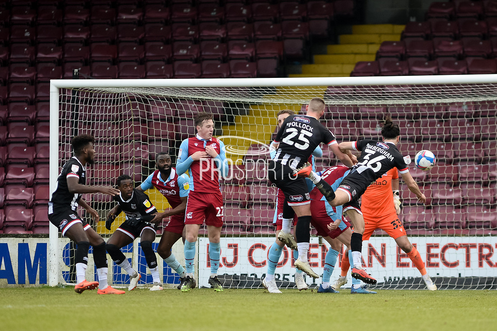 Grimsby Town Mattie Pollock (25) heads the ball, misses the target during the EFL Sky Bet League 2 match between Scunthorpe United and Grimsby Town FC at the Sands Venue Stadium, Scunthorpe, England on 23 January 2021.
