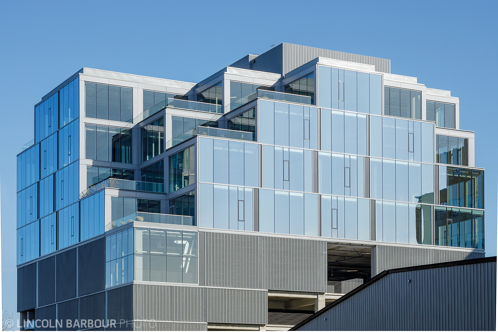 A horizontal view of the top half of the 7 Stark Building in Portland, Oregon showing how the building looks like giant stairs or stacked blocks.