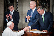 Pope Francis shakes hands with Speaker of the House John Boehner as he arrives in the chamber of the House of Representatives as he continues his six-day U.S. tour speaking to a joint meeting of Congress at the U.S. Capitol in Washington, District of Columbia, U.S., on Thursday, Sept. 24, 2015. The Pope is calling for Americans to do more to fight poverty, curb climate change and help immigrants. His visit runs through Sept. 27, and features stops in Washington, New York and Philadelphia. Photographer: Pete Marovich/Bloomberg