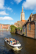 A tourist boat on a canals in Bruges