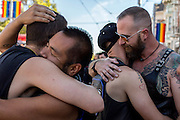 From right to left: Rick Padre, Trevor Ott, Jacob Ray and Ken Wells embrace before LeatherWalk 2016: Kinky Leather Parade on Sunday, Sept. 18, 2016 in San Francisco, Calif. The 25th-annual event kicked off Leather Week in San Francisco, which will culminate with the Folsom Street Fair on Sunday.