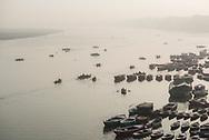 Boats on the River Ganges at sunrise, Varanasi, Uttar Pradesh, India