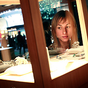 A Russian woman looks at jewelry the Millionaire Fair in Moscow. .Millionaires, billionaires and those who bought 1,000-rouble tickets were among the thousands who visited the fair held in the Crocus city expo centre. .The four-day event, held for the second year in a row, ended on October 30. The products on sale include a diamond-studded mobile phone worth a million dollars, an island, latest sports cars and other items that might appeal to the growing millionaire market..Twenty years ago, there were no official millionaires in the whole of Russia. Now Moscow has 25 billionaires and the country has 88,000 millionaires, according to Forbes Magazine. ..