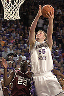 Kansas State's Tyler Hughes (R) drives and scores over Texas A&M's Josh Carter ((R) during K-State's 58-54 win over the Aggies at Bramlage Coliseum in Manhattan, Kansas, January 18, 2006.