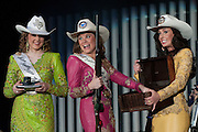 The Rode Austin Gala was held Saturday February 12, 2011 at the Palmer Events Center. Courtney Elliott (L) Miss Rodeo Texas Teen, Kitsy Tuck (C) Miss Rodeo Austin Princess and Grace Crews, Miss Rodeo Austin, pick the winning raffle ticket for a rifle.
