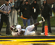 Alabama RB T.J. Yeldon (4) splashes water as he crashes into the end zone for another touchdown for the Crimson Tide in the second quarter,  in their game against the Missouri Tigers at Memorial Stadium on Saturday October 13, 2012 shortly before lightning suspended the game.  His touchdown made the score 20-0, and the PAT upped that to 21-0.  The game was temporarily suspended due to lightning with 8:40 remaining in the second quarter.