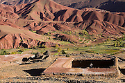 A child plays on a farm roof in Tasgaiwalt in the lush Tessaout Valley, M'Goun Massif, Central High Atlas, Morocco.