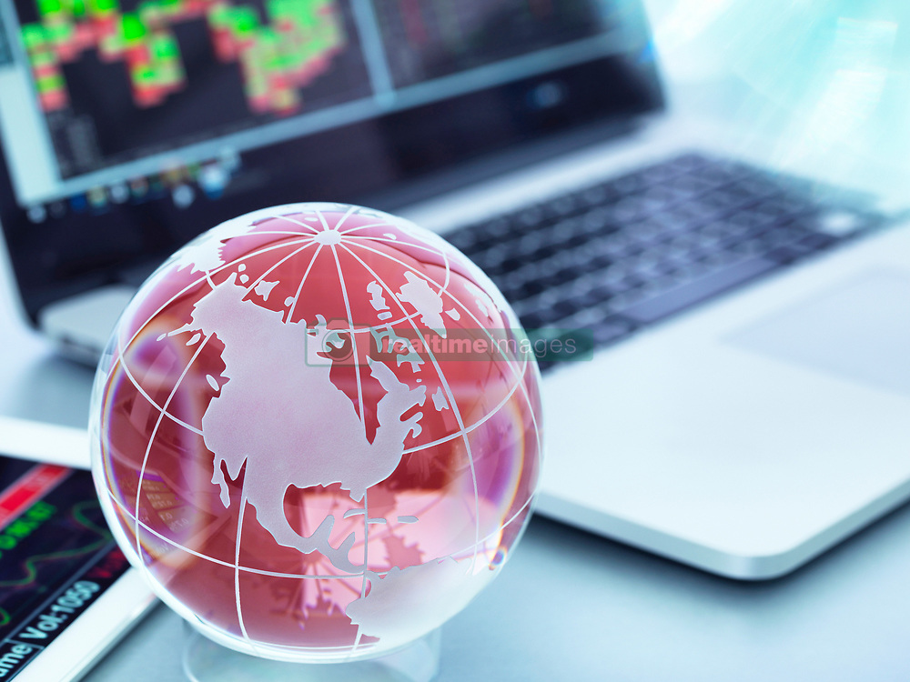 May 11, 2017 - Globe with digital tablet and laptop showing international business trade (Credit Image: © Andrew Brookes/Image Source via ZUMA Press)
