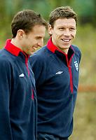 Photo: Scott Heavey.<br />England Training session at London Colney. 29/03/2004.<br />Gareth Southgate (L) enjoys a joke with Alan Thompson