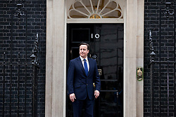 © Licensed to London News Pictures. 18/01/2012. LONDON, UK. The  British Prime Minister, David Cameron, waits on the steps of Downing Street in London today (18/01/12) to meet Italian Prime Minister, Mario Monti. The par met today to discuss the current eurozone crisis. Photo credit: Matt Cetti-Roberts/LNP