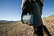 Africa, Namibia - on road to Puros I met a boy who walked up by himself with just an old enamel cup asking for water.