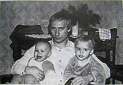 Before rising to power as one of the most infamous leaders in the world, Putin was a playful, hipster-dressing man in love. circa 1988 - Russia - A young VLADIMIR PUTIN with his daughters. (Credit Image: © Russian Archives via ZUMA Wire)