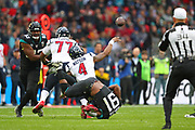 Houston Texan's quarterback, Deshaun Watson (4) throws a pass as he is tackled by Jacksonville Jaguars defensive end, Yannick Ngakoue (91) during the NFL game between Houston Texans and Jacksonville Jaguars at Wembley Stadium in London, United Kingdom. 03 November 2019
