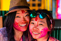 Young Chinese tourists at Holi Festival, Mathura, Uttar Pradesh, India.