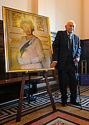 "© Licensed to London News Pictures. 02/02/2012, Kingston Upon Thames, UK. 104 year-old becomes Britain's oldest new citizen. Mr Khanjar with a portrait of Queen Elizabeth II. 104 year-old TAUFEEK KHANJAR became a British Citizen at a ceremony held by Surrey County Council today (01 February 2012). Mr Khanjar is originally from Iraq and worked as a jewellery maker in Baghdad. He came to the UK six years ago to live with his daughter Nada Dabis, 59, in South Cheam, Surrey, where he enjoys walking, feeding the birds, playing cards and listening to music. He is a widower with four sons and two daughters. Durning the ceremony Mr Khanjar took an oath to the Queen, pledging that he will be a faithful citizen and obey the laws of the country. He explained the secret to a long and healthy life was to ""never get stressed and be relaxed"".  Photo credit : Stephen Simpson/LNP"