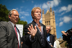 © Licensed to London News Pictures. 01/07/2019. London, UK. Sir Cliff Richard (centre) joins Paul Gambaccini and others at the launch of a campaign calling for a ban on naming sex crime suspects unless they have been charged. Photo credit: Rob Pinney/LNP