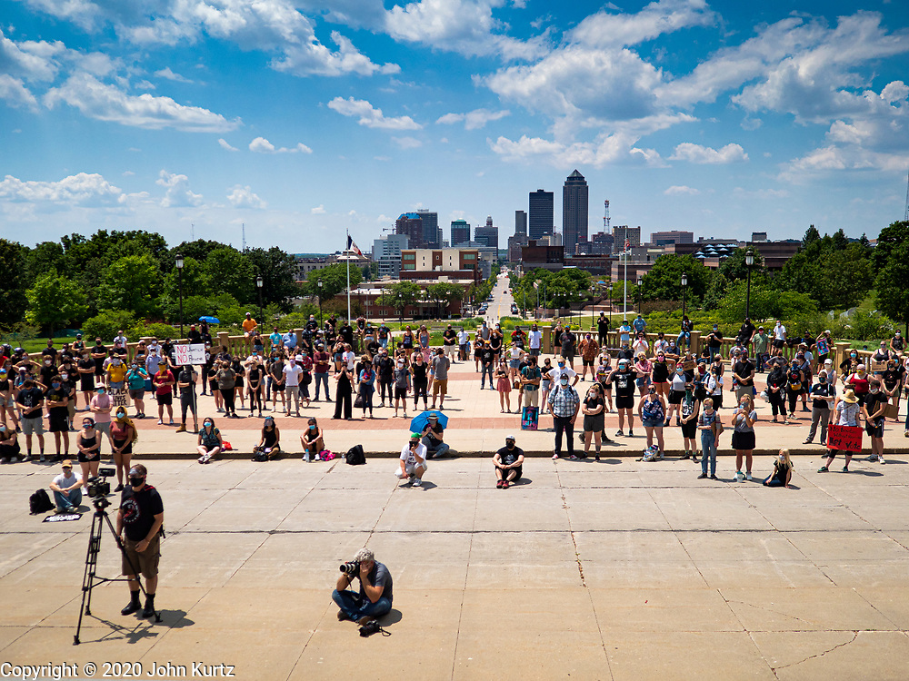 04 JULY 2020 - DES MOINES, IOWA: Protesters gather on the plaza in front of the Iowa State Capitol with downtown Des Moines behind them. Hundreds of people came to the grounds of the Iowa State Capitol to protest against and in favor of historic monuments on the capitol grounds. Several hundred people protested against a monument to Christopher Columbus and the stereotypical depiction of Native Americans on the capitol grounds. About 50 people came to the capitol to rally in support of the monuments. The protest against the monuments was organized by Seeding Sovereignty, a collective of indigenous women. The rally to defend the monuments was organized by an Iowa chapter of Three Percenters.     PHOTO BY JACK KURTZ