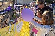 A memorial was created at Mesa Verde Elementary School where student, Christina Taylor Green, 9, was a student.  Green was killed during an assassination attempt on Arizona Congresswoman, Gabrielle Giffords, in Tucson, Arizona, USA, on January 8, 2011.  Heidi Radtke and her daughters, Lauren, (left), 4, and Hannah, 7, pay their respects.