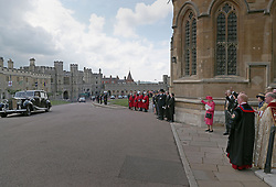 Members of the royal family wave at the bride and groom after the wedding of Lady Gabriella Windsor and Thomas Kingston at St George's Chapel in Windsor Castle.