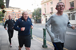 Foreign Secretary Boris Johnson takes an early morning run before the start of the third day of the Conservative party conference at the ICC in Birmingham.