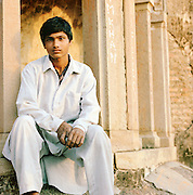 Local man in front of The Great Imambara, Lucknow, Uttar Pradesh, India
