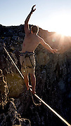 Shaun Wakelin walks the slackline, 1,085m above the sea below. This 150 metre long slackline stretches across Union Ravine on Table Mountain, Cape Town. Picture by Greg Beadle