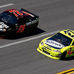 April 17, 2011; Talladega, AL, USA; NASCAR Sprint Cup Series driver Regan Smith (78) and Paul Menard (27) during the Aarons 499 at Talladega Superspeedway.   Mandatory Credit: Derick E. Hingle