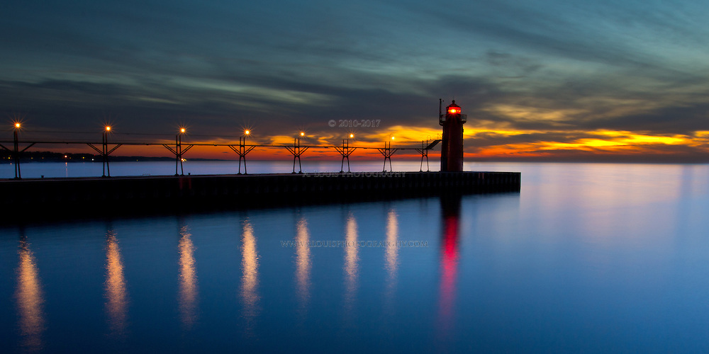 A calm, after sunset shot of the South Haven, MI lighthouse and pier