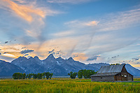 The sun sets behind the Moulton Barn in Grand Teton National Park. This 100 year old building is on Antelope Flat Road.