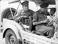 British photographer Terry Fincher seen as an accredited war photographer during the Suez Crisis in 1956.