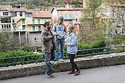 November 8, 2016 - Breil-sur-Roya, France: Cedric Herrou (L), a 37-year-old farmer, with two other activists, Lucille and Emile. They are members of a clandestine network that helps migrants who walked into the valley from Ventimiglia, Italy. <br /> <br /> 8 novembre 2016 - Breil-sur-Roya, France: Cedric Herrou (G), agriculteur de 37 ans, avec deux autres activistes, Lucille et Emile. Ils sont membres d'un réseau qui aide les migrants qui sont venus à pied de Vintimille.