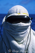 photographer James D. Watt ( Jim Watt ), wearing virtual reality glasses and wrapped in towels to block the sun while using a remote camera ( polecam ) to photograph sharks at Bikini Atoll, Marshall Islands