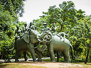 16 JULY 2014 - SAMUT PRAKAN, SAMUT PRAKAN, THAILAND: A statue marking the historic elephant duel between Thailand and Burma. In 1592 A.D. King Naresuan the Great fought the Deputy King of Burma in an elephant-back duel. Naresaun and his elephant defeated and killed the Burmese. Ancient Siam is a historic park about 200 acres (81 hectares) in size in the city of Samut Prakan, province of Samut Prakan, about 90 minutes from Bangkok. It features historic recreations of important Thai landmarks and is shaped roughly like the country of Thailand.      PHOTO BY JACK KURTZ