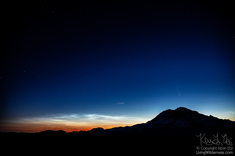 Mount Rainier, the tallest mountain in the Cascade Range, is rendered in near silhouette as Comet C/2020 F3 (NEOWISE) and noctilucent clouds provide some light in the twilight sky in this view from High Rock in Washington state. Comet NEOWISE is a long-period comet and its current orbital path will take about 6,800 years to complete. Its nucleus is about 3 miles (5 kilometers) across and is covered with sooty, dark particles left over from its formation near the birth of our solar system 4.6 billion years ago.