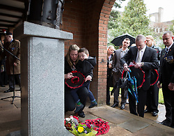 © Licensed to London News Pictures . 29/03/2015 . Manchester , UK . Rebecca Rigby ( Lee Rigby's widow ) and son Jack lay a poppy wreath at the base of the memorial . A bronze drum , in memory of Fusilier Lee Rigby , is unveiled in Middleton Memorial Gardens , North Manchester at a memorial service in his honour . Rigby was murdered in a terrorist attack in Woolwich in May 2013 . Photo credit : Joel Goodman/LNP