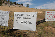 Hand painted signs of a local resident of Boulder Valley, Montana. The signs at the entrance to the residents land used to be far more racially charged, although have now developed his brand of sloganing into other political areas.
