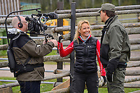 SVT television host and cameraman interviewing Mikael Jansson, manager at Avesta Visentpark. Transportation of European Bison, or Wisent, from the Avesta Visentpark, in Avesta, Sweden. The animals were then transported to the Armenis area in the Southern Carpathians, Romania. All arranged by Rewilding Europe and WWF Romania, with financial support from The Dutch Postcode Lottery, the  Swedish Postcode Foundation and the Liberty Wildlife Fund.