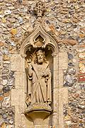 Stone statue of Saint Andrew church of Ilketshall St Andrew, Suffolk, England, UK