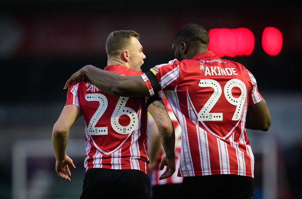 Lincoln City's Harry Anderson, left, celebrates scoring the opening goal with team-mate John Akinde<br /> <br /> Photographer Chris Vaughan/CameraSport<br /> <br /> The EFL Sky Bet League Two - Saturday 15th December 2018 - Lincoln City v Morecambe - Sincil Bank - Lincoln<br /> <br /> World Copyright © 2018 CameraSport. All rights reserved. 43 Linden Ave. Countesthorpe. Leicester. England. LE8 5PG - Tel: +44 (0) 116 277 4147 - admin@camerasport.com - www.camerasport.com