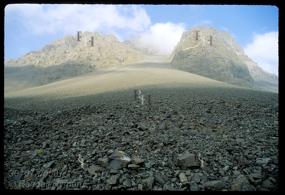 Long talus slope leads to base of mountains near cape of Stokksnes on southeast tip of island; Hofn, Iceland.