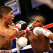 Richard Rodriguez lands a left shot the head of Jonathan Gonzalez during a Telemundo boxing match between at Osceola Heritage Park on Friday, February 23, 2018 in Kissimmee, Florida.  (Alex Menendez via AP)