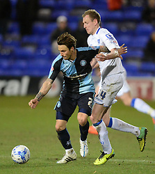 Wycombe Wanderers's Sam Saunders competes with Tranmere Rovers's Marc Laird - Photo mandatory by-line: Richard Martin-Roberts/JMP - Mobile: 07966 386802 - 03/03/2015 - SPORT - football - Tranmere - Prenton Park - Tranmere Rovers v Wycombe Wanderers - Sky Bet League Two