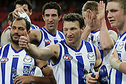 Brent Harvey and Kangaroo team mates celebrate at full time of the AFL Round 23 match between the GWS Giants and the North Melbourne Kangaroos at Skoda Stadium, Sydney. (Photo: Craig Golding/AFL Media)