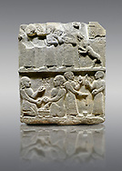 """Picture & image of Hittite monumental relief sculpted orthostat stone panel of Royal Buttress. Basalt, Karkamıs, (Kargamıs), Carchemish (Karkemish), 900 - 700 B.C. Anatolian Civilisations Museum, Ankara, Turkey.<br /> <br /> This panels scene showing 8 out of 10 children of the King, the hieroglyphs reads as follows: """"Malitispas, Astitarhunzas, Tamitispas,Isikaritispas, Sikaras, Halpawaris, Ya hilatispas"""". Above, there are three figures holding knucklebones (astragalus) and one figure walking by leaning on a stick; below are two each figures playing the knucklebones and turning whirligigs.  <br /> <br /> Against a gray background. .<br />  <br /> If you prefer to buy from our ALAMY STOCK LIBRARY page at https://www.alamy.com/portfolio/paul-williams-funkystock/hittite-art-antiquities.html  - Type  Karkamıs in LOWER SEARCH WITHIN GALLERY box. Refine search by adding background colour, place, museum etc.<br /> <br /> Visit our HITTITE PHOTO COLLECTIONS for more photos to download or buy as wall art prints https://funkystock.photoshelter.com/gallery-collection/The-Hittites-Art-Artefacts-Antiquities-Historic-Sites-Pictures-Images-of/C0000NUBSMhSc3Oo"""