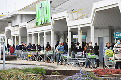 © Licensed to London News Pictures. 17/04/2020. Brighton, UK. Shoppers queue at an ASDA store in Brighton during a pandemic outbreak of the Coronavirus COVID-19 disease. Photo credit: Liz Pearce/LNP.