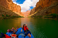 Relaxing on a flat water stretch, Whitewater rafting trip (oar trip) on the Colorado River in Marble Canyon, Grand Canyon National Park, Arizona USA