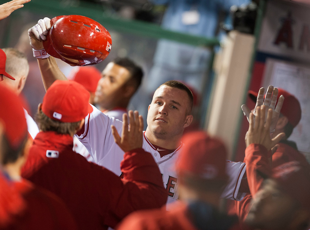 The Angels' Mike Trout is welcomed into the dugout after scoring in the fifth inning against the Dodgers Wednesday night at Angel Stadium.<br /> <br /> ///ADDITIONAL INFO:   <br /> <br /> angels.0519.kjs  ---  Photo by KEVIN SULLIVAN / Orange County Register  -- 5/18/16<br /> <br /> The Los Angeles Angels take on the Los Angeles Dodgers in inter-league play at Angel Stadium Wednesday night.
